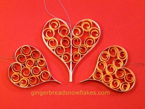 Festive Heart ornaments made using Barc paper and curled shaved wood.  Learn where to find both and how to use them here: http://gingerbreadsnowflakes.com/node/840