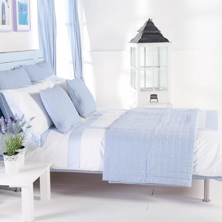 Exciting Bedroom Interior Design With White Blue Duvet Cover King Plus Pillow On The Bed Along With Blue Curtain Corner Glass Window And White Wooden Small Table Flower Vase The Top Best Duvet Covers King; the Focal Point of Beauty in Your Bedroom Bedroom design