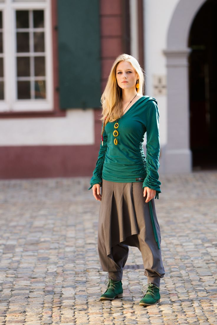 Malva Trousers with attached skirt part in the front. The buttons from rough coconut-wood are a beautiful eye-catcher on Front & Back (Buttons are only deco not for opening). Elastic waistline.  Material: 95% Organic-Cotton, 5% Elastane,   http://www.ajna-design.com/Women/Women-Trousers/Malva/Malva-grey::773.html