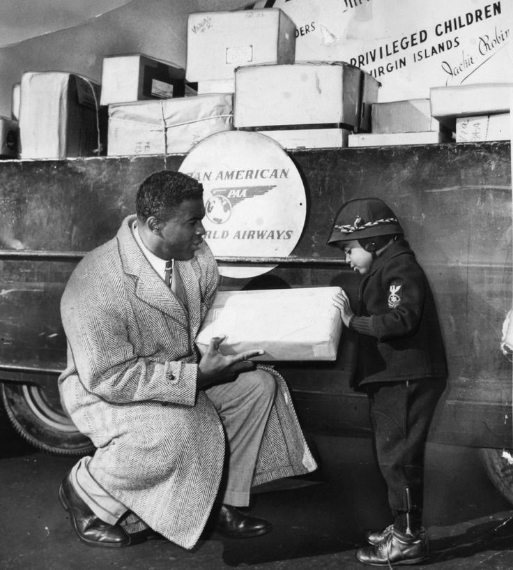 Legendary baseball player Jackie Robinson spreading a bit of holiday cheer in 1950.