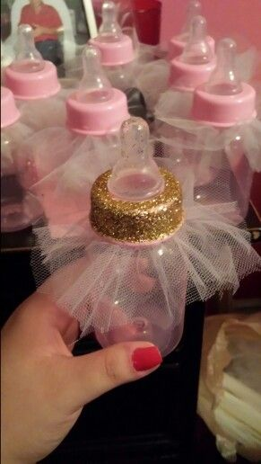 Diy princess baby bottle Add glitter around the top rim without the mouth piece and than add 3 squate pieces if tulle and put top back and you can add what you like inside.