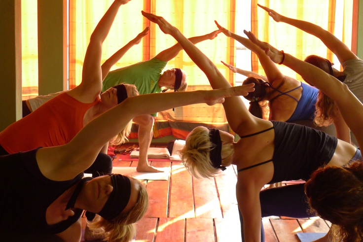 Blindfolded side angle on retreat in India » Yoga Pose Weekly