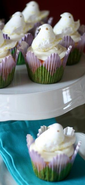 Funfetti Cupcakes with Orange Creamcheese Frosting are the perfect flavor and look for a festive cupcake style.