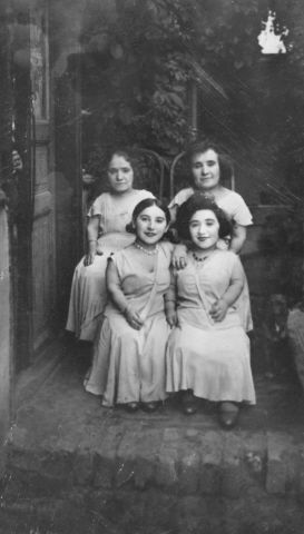 Four female members of the Ovici family, a family of Jewish entertainers known as the Lilliput Troupe, who survived Auschwitz.