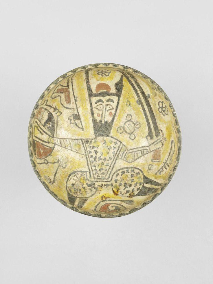 Bowl with a Man Holding a Sword and Shield, 10th Century, Nishapur, Iran. Bonhams