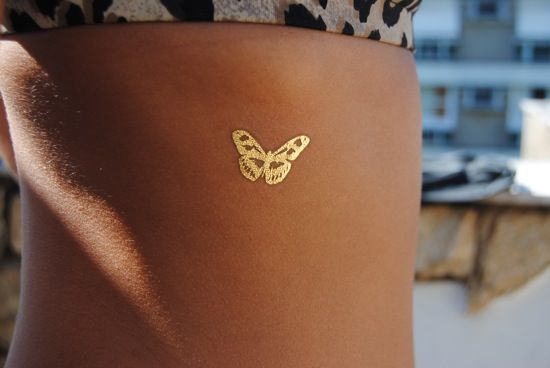 A gold butterfly... reviewed by Beta Fashionite ;)    @Adina Zacharias Martinez You can order these 24K gold tattoos from GoldTattoosUS.com.They last 3 to 5 days!
