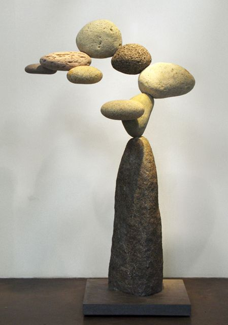 """^The art of sculptor Woods Davy is both inspired by nature and composed of natural elements. The artist, who lives and works in Venice, California, creates what he calls a sense of """"Western Zen"""" with his gravity-defying rock sculptures. His Cantamar and Granite series feature a number of collected stones arranged in an impossible balancing act, leaving one to reflect on its unnatural configuration and one's own spirituality."""