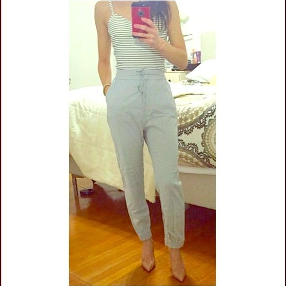 """High waist Black linen pants Never worn.. Black linen pants with drawstrings and two side pockets  size 2 in H&M which is equivalent to xs ... The picture on the first one is grey in color same style as the black for model purposes.. I'm 5'2"""" H&M Pants"""