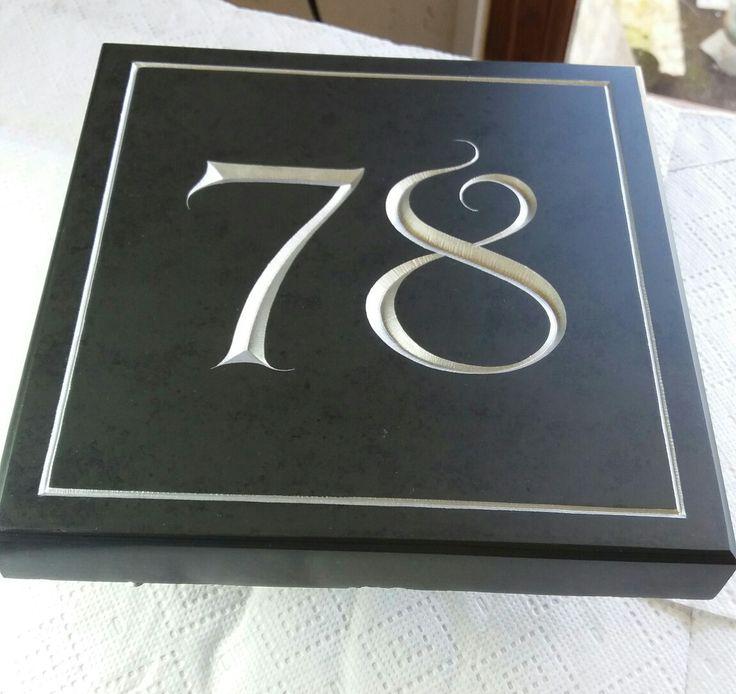 Deep V cut number sign in Brazilian slate. By Dan Anderson
