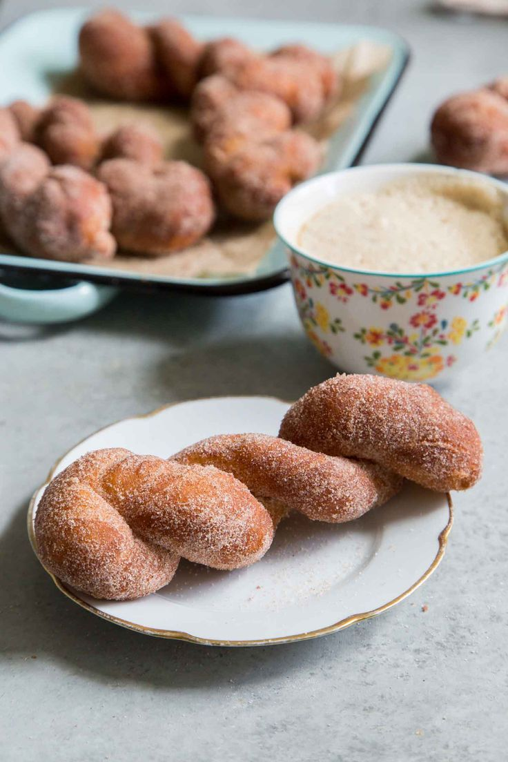 These cinnamon sugar twist doughnuts are a cross between crunchy churros and soft, fluffy beignets. Shape the dough into twists, punch out rounds, or slice them into squares. After they are fried to a golden crisp, the doughnuts get a generous coating of cinnamon sugar.