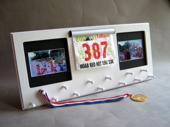 White Sport Medal display with clamp bib holder and photo frames. Black mat. on Etsy, $69.00