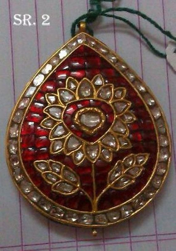 This is a beautiful ruby and Diamond / Polki Pendant. Stones used: Ruby Real Natural Antique cut Diamonds (Polki) Metal: 22K Gold