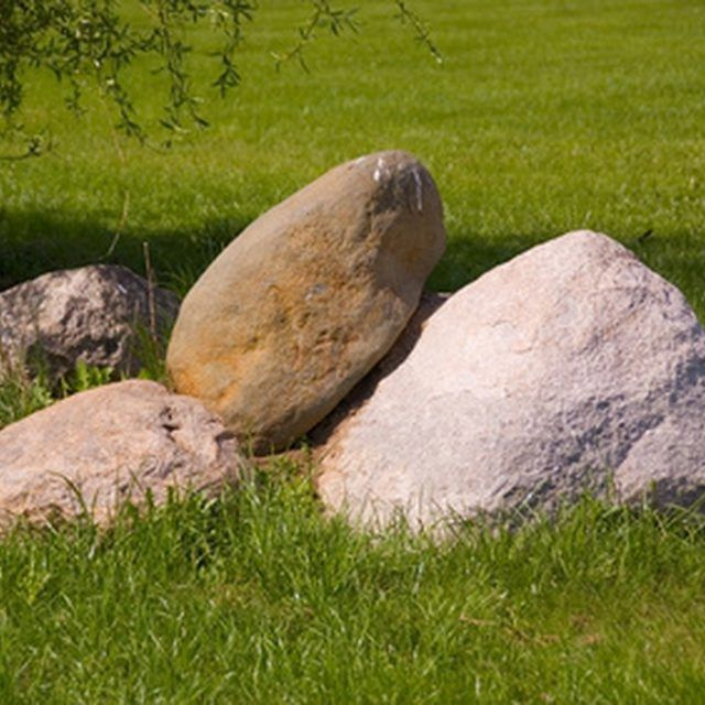 Large rocks can hide unsightly areas of your yard.