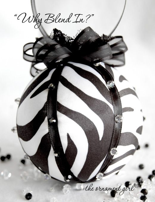 Zebra Ornament--alternating pieces of zebra fabric surround the ornament, accented with strips of black satin ribbon and rows of black and clear sparkling crystal beads... topped off the ornament with semi sheer ribbon , black lace, and a red crystal bead to add a tiny, contrasting splash of color.