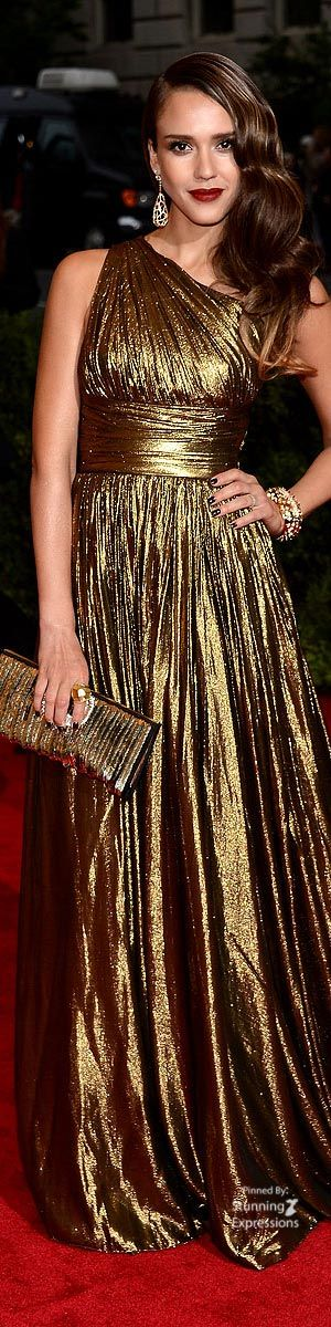 Jessica Alba. This gold gown looks like a Maria Lucia Hohan creation, but I don't know for sure.