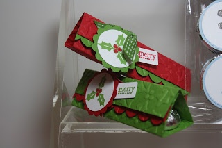 """Holiday examples of a Triangle Treat Holder (can hold up to 4 Hershey Kisses). Cut your cardstock or patterned paper at 4-1/4"""" x 5-1/2"""". Parallel to the short side, score at 1-1/2"""", 3"""" and 4-1/2"""". Wrap shortest length to the front and trim with scallop edge. Mini Glue Dots are excellent for holding kisses in place! If you don't want the holder ripped apart, you can tie it closed with ribbon, or use a velcro dot."""
