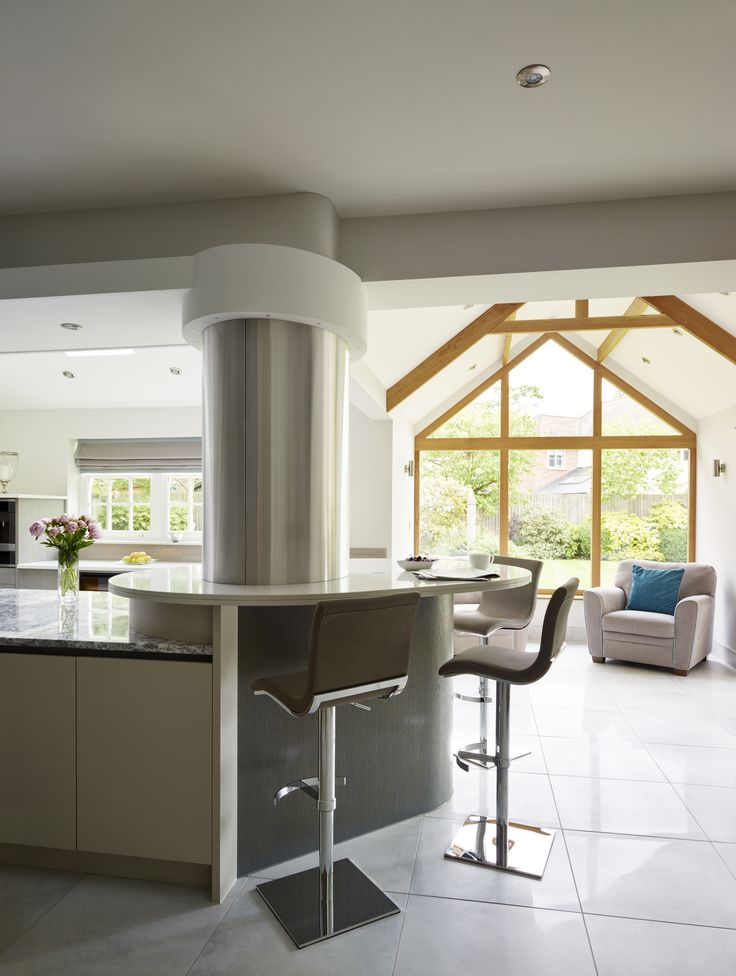 """""""If you are planning a glazed extension, such as an orangery or garden room, then it's important to think about how the room is laid out. Think about how you would like to use it, perhaps with soft seating and a dining table, leaving the kitchen within the main building."""" - wise words from Richard Davonport of Davonport Interiors, showcased in this stunning kitchen he designed"""