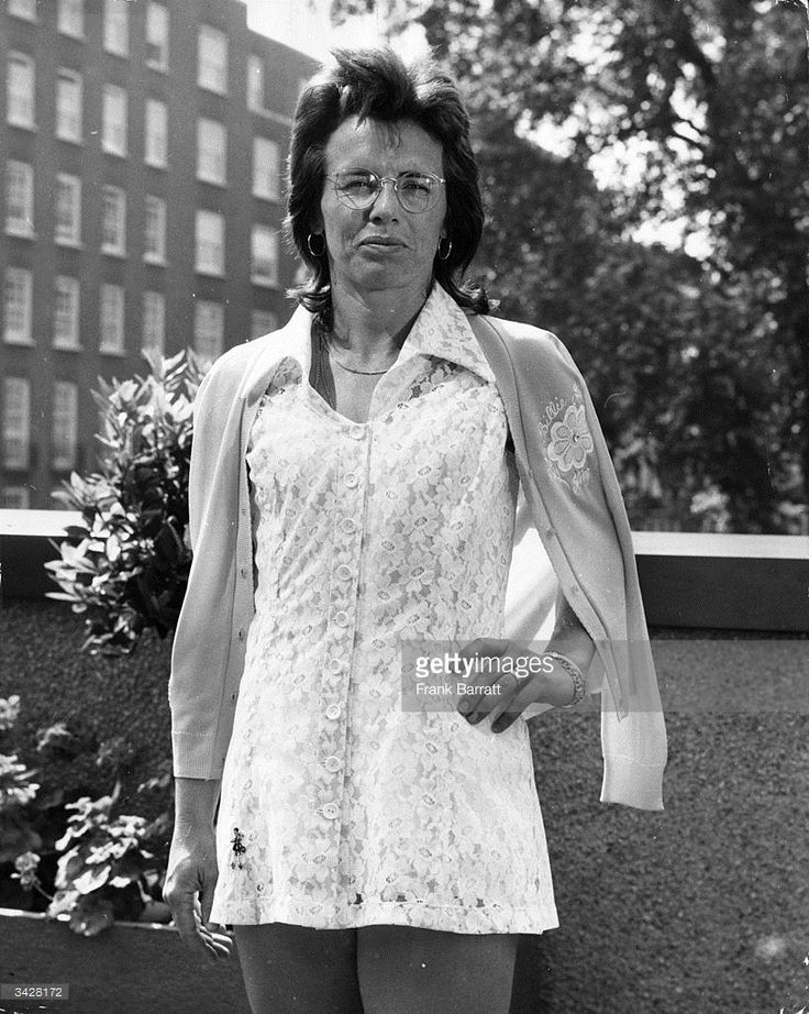 1974: America's Billie Jean King sporting her latest Wimbledon tennis dress, a white lace creation by Teddy Tingling, at a pre-match press photocall in Knightsbridge, London.
