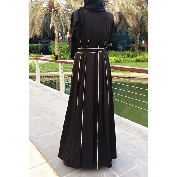 Trendy abaya with panels and contrast hemming stitch decor in beige color. Relaxed fit and flowing silhouette. Flared cut. Kimono sleeves. Made of premium blac