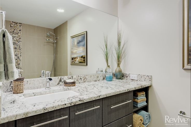 This contemporary vanity offers a lot of storage space while still keeping the room open.