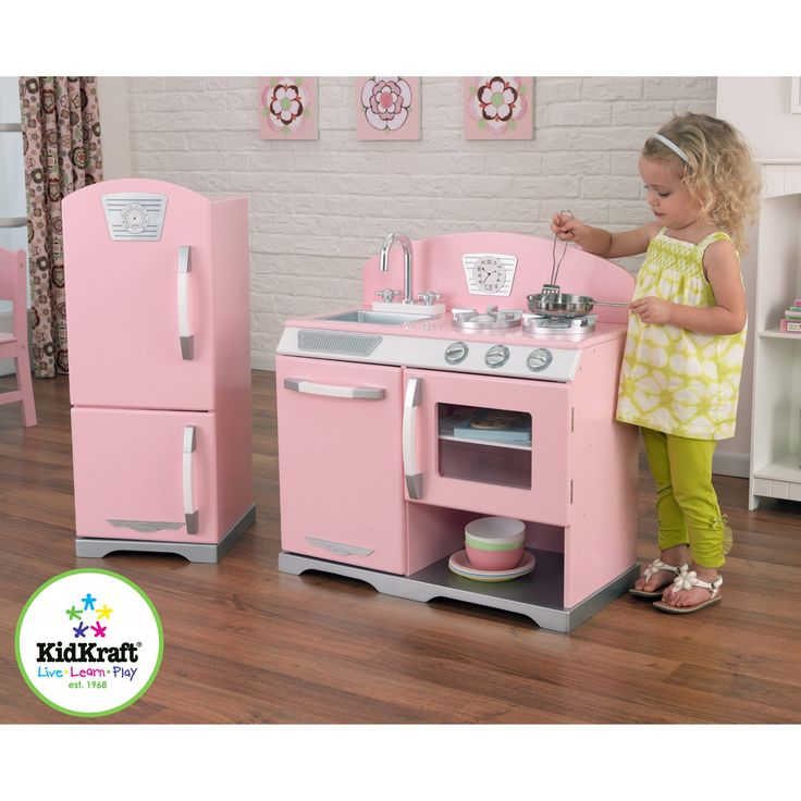 look at her with the little spatula in the pan…I can't take it! :-D ----- KidKraft 2 Piece Pink Retro Kitchen and Refrigerator - Play Kitchens at Hayneedle