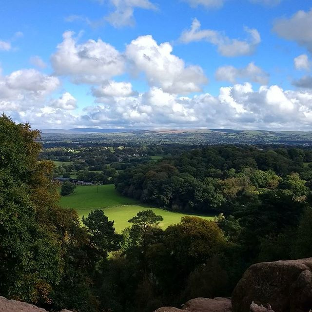 Ahead, Derbyshire and the Peak District. . Behind, the Cheshire Plain and the Irish Sea. . Beneath, King Arthur, Merlin and an Army of Knights slumber inside a cave until called upon in times of trouble to save the realm. . Walkies on top of Alderley Edge, a sandstone outcrop fizzing with ancient folklore.  Afternoon tea at the Wizard, first passing a well carved into the cliff face: 'Drink of this and take thy fill, for the water falls by the wizard's will'. Shall attempt to post a clip of…