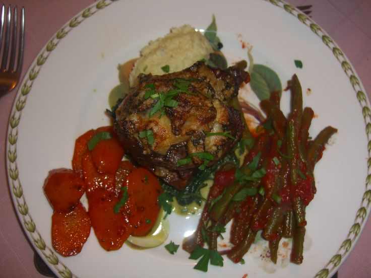 Main course by Charlotte Leventis. Fillet of beef with gratin of wild mushrooms with parsnip puree, carrots & beans with tomatoes.
