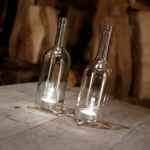 Genomskinliga lyktor av vinflaskor