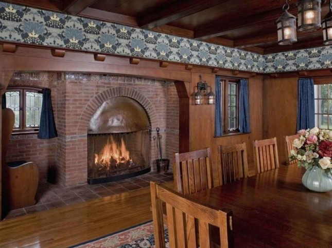 sweet inglenook, wallpaper frieze, heavy high mantle - could be incorporated for family room...molding over top of china closet over to FP??