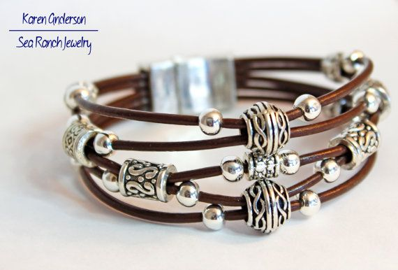 Leather cords with a beautiful variety of silver plated Bali/tribal beads create this casual ethnic boho stack bracelet. In your choice of 5                                                                                                                                                                                 Mais