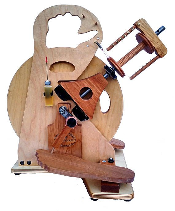 The HitchHiker is an ultra portable spinning wheel designed to do all the functions but on an airline carry-on size. Accessories such as spare bobbins, oil bottle and orifice hook are on-board. Originally designed for the members of a small spinning group in 2005 it now has homes all over