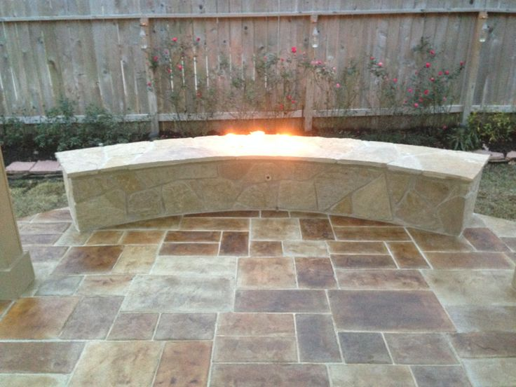 Stamped Concrete Patio With Curved Fire Pit Backyard