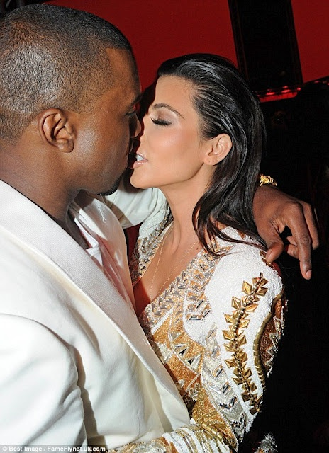 kim and Kany west passionate kiss in Cannes