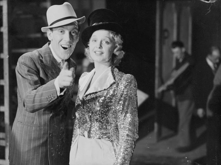 Wartime Entertainers: Comedian Tommy Trinder pictured with actress Jean Colin during a scene from 'Communal Kitchen', a Ministry of Information film release. In addition to its public information and propaganda films, the Ministry also produced humorous films designed to boost morale.