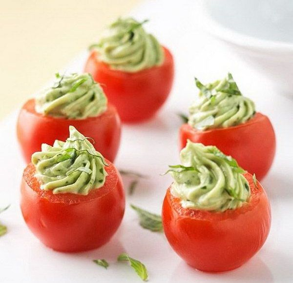 Stuffed Cherry Tomatoes. Stir mayonnaise, bacon, green onion and avocado mixture. Spoon avocado mixture into scooped out tomato shells. Sprinkle some ingredients to add up perfect flavor to treat your guests. http://hative.com/creative-diy-party-food-ideas/