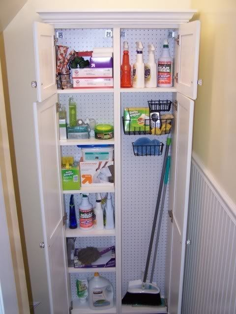 The Garden Web: Make use of an extra nook in your home by adding in a freestanding cabinet like this one. You'll need to think vertically in order to have enough space for your brooms and cleaning supplies.