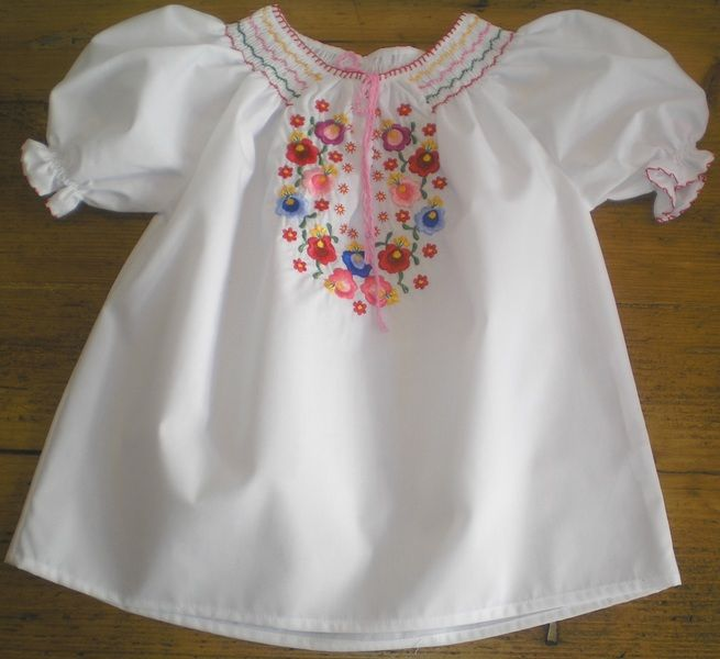 Blouse for children with hungarian motives embroidered on it.