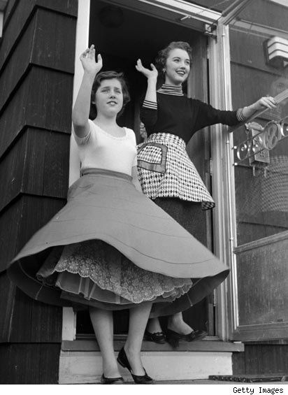 2 young ladies in the early 50s... poodles were common decorative features on these skirts.