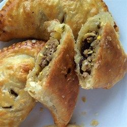 "Argentinian Beef Empanadas | ""My family loves these juicy meat pies with raisins, chopped olives, and hard-boiled eggs. This recipe is always a hit."""