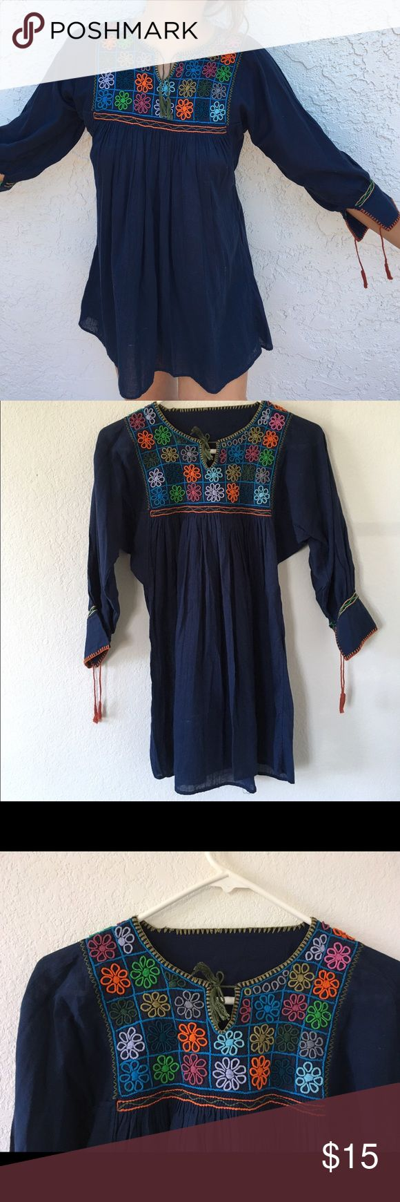 New!! Hand embroidered Mexican shirt! New! Never worn except to take this photo to show how it looks on. Very flattering. Colorful. Bought it in an outdoors market in Mexico. Selling it because I have many shirts like it. Tops Blouses