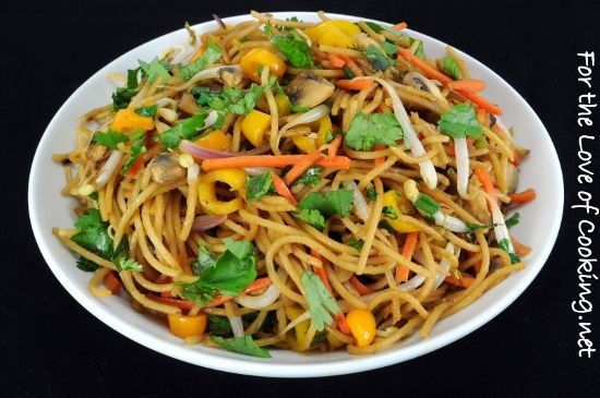 VEGETABLE LoMEIN 8 oz Whole wheat spaghetti noodles, cooked   1/2 tsp sesame oil  2 tbs hoisin sauce  1 tbs soy sauce  1 tbs canola oil (divided)  1 c of mushrooms, sliced  1/2 c of shredded carrots  1/2 c of baby bell peppers, sliced  1/4 red onion, sliced  2 green onions, chopped  1/2 c of mung-bean sprouts  1/2 tbs fresh ginger, minced  3-4 cloves of garlic, minced  2 tbs fresh cilantro, chopped (divided)