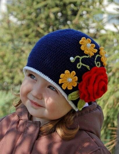 Crochet hat with beautiful flowers