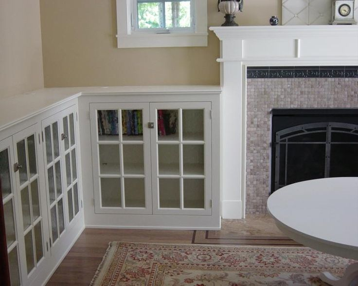 Craftsman style built-in bookcase with leaded-glass doors. like how they turn the corner. and of course all much brighter in white, though not authentic to period. does brighten the room though.