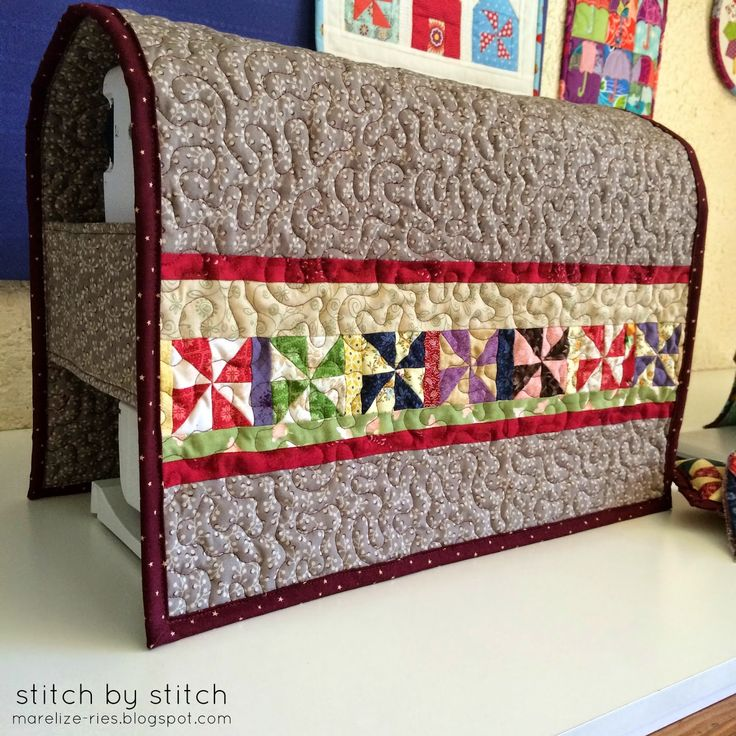 Quilted sewing machine cover.  Like the sides being open for how different machines have different bumps and protrusions or cords in different spots.
