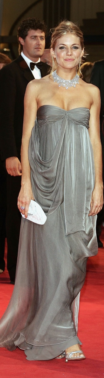 Dior!!! The grey is soft the drapes are beautiful this dress and the jewellery are just breathtaking it's one of my all time favourite outfit looks of the red carpet