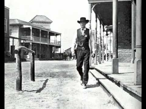 High Noon, sung by Frankie Laine in this version, is an American 1952 western film directed by Fred Zinnemann and starring Gary Cooper and Grace Kelly. The film tells in real time the story of a town marshal forced to face a gang of killers by himself. The screenplay was written by Carl Foreman, based on John W. Cunningham's Collier's magazine s...