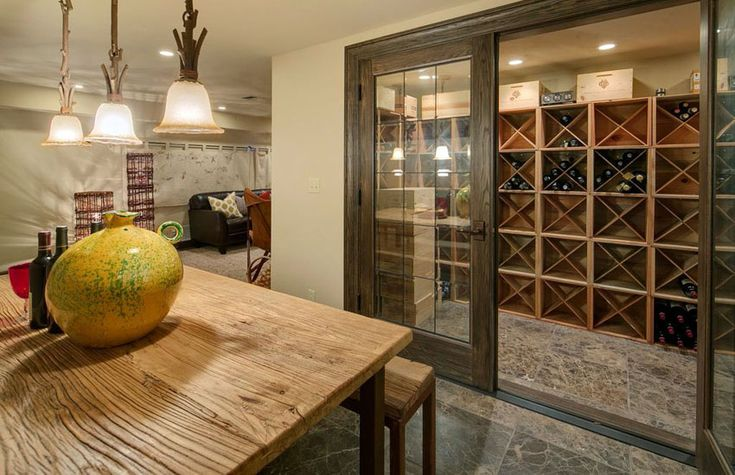 Craftsman basement with walk in wine cellar with sliding glass doors