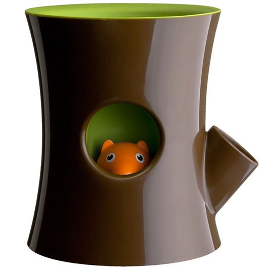 """Squirrel in Log Plant Pot...Instead of watering your plant the """"old fashioned"""" way (i.e. adding water on top of the soil), there is a water reservoir that feeds your plant from the bottom up. If Mr. Squirrel's head sinks below the hole, that means your plant wants a refill!"""