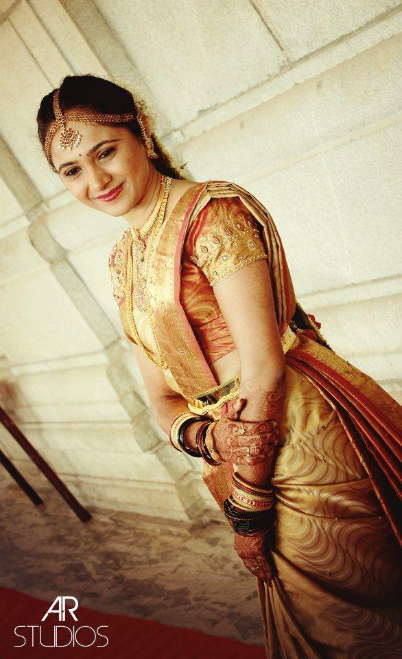 South Indian bride. Indian diamond bridal jewelry. Jhumkis.Gold silk kanchipuram sari.Braid with fresh jasmine flowers. Tamil bride. Telugu bride. Kannada bride. Hindu bride. Malayalee bride.Kerala bride.South Indian wedding.