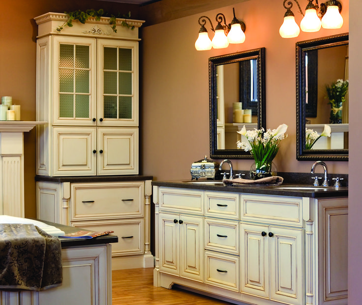 Canterbury Style Cabinets With Antique White Paint And Pewter Accent.